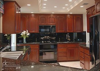 Kitchen remodel with cherry wood, liberty style upper doors, revere style doors on base cabinets.